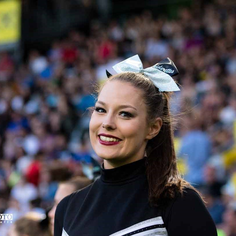 Laura Moser Student Business & Management and RAIDERETTE.